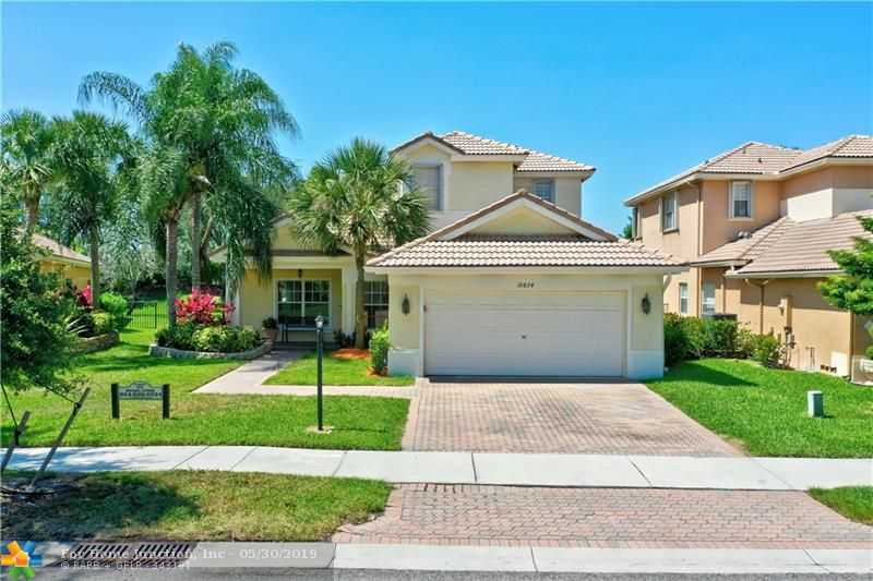 $519,900 - 4Br/3Ba -  for Sale in Parkland Isles, Parkland