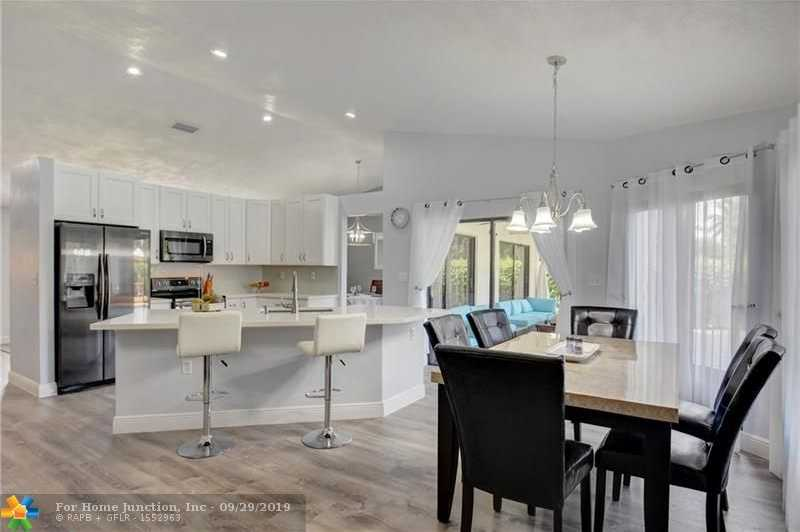 $459,900 - 4Br/3Ba -  for Sale in Butler Farms Sec Two, Coral Springs