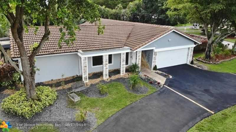 $469,900 - 4Br/2Ba -  for Sale in Coral Spgs Country Club W, Coral Springs