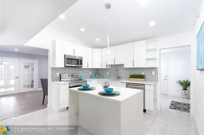 $349,900 - 4Br/2Ba -  for Sale in Palm Lane Villa 4 45-21 B, Hollywood