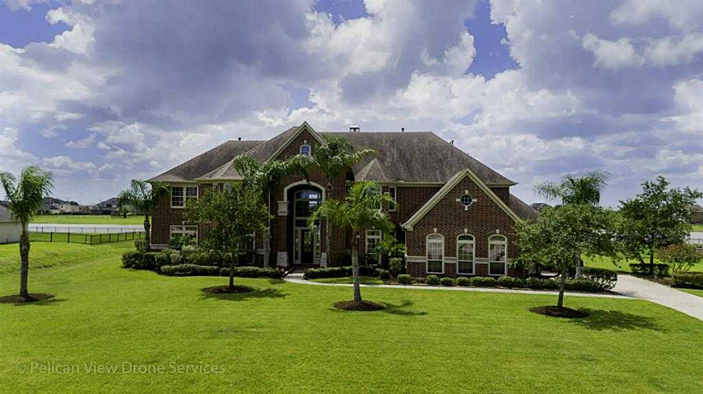 $889,900 - 5Br/6Ba -  for Sale in Whispering Lakes Ranch Sec 2, League City