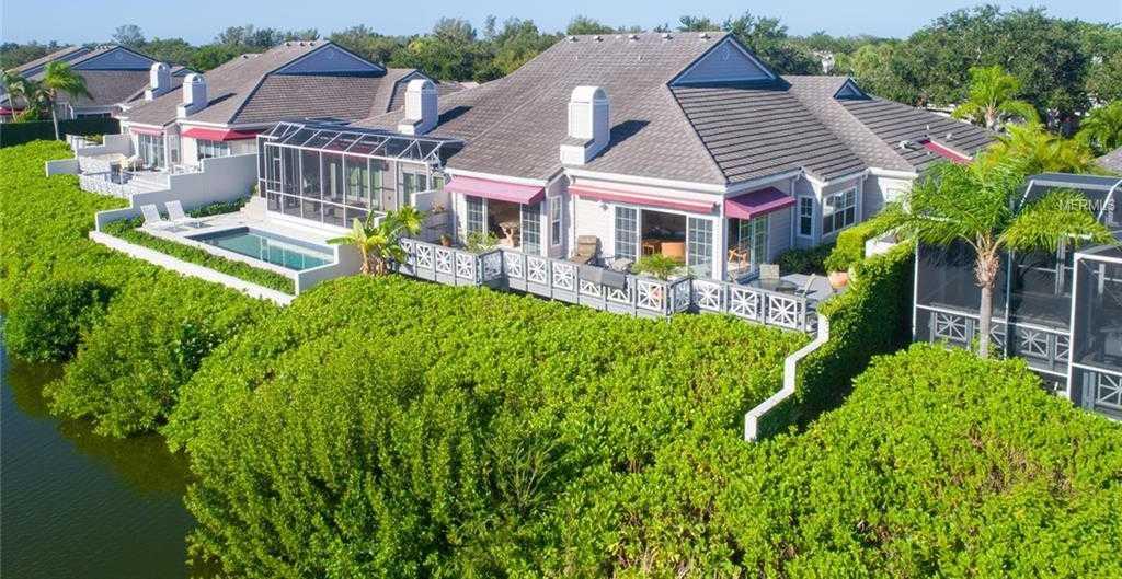 $974,900 - 2Br/3Ba -  for Sale in Winding Oaks, Longboat Key