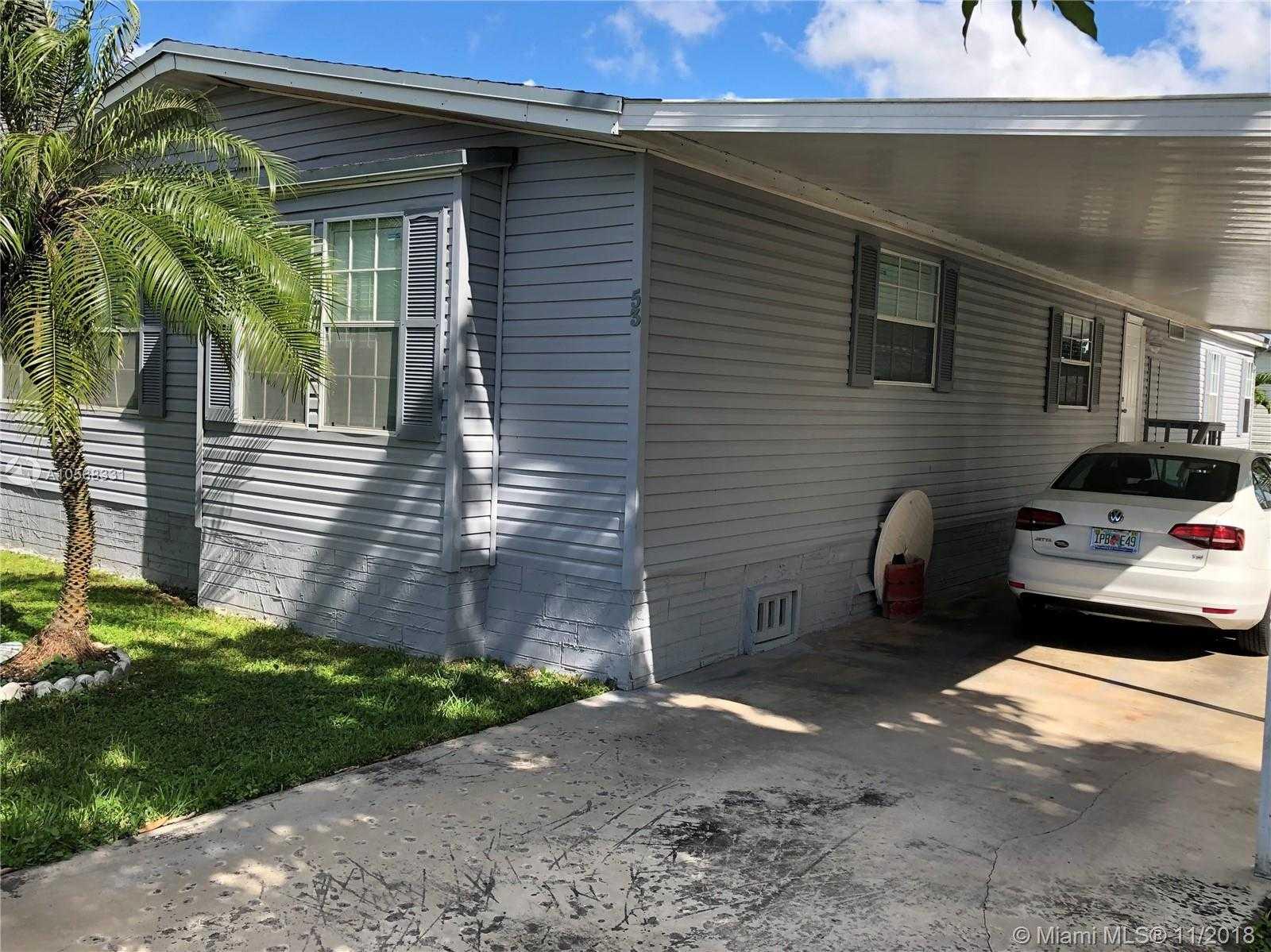 $153,000 - 4Br/3Ba -  for Sale in Americana Village Condo, Miami