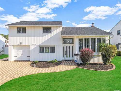 $779,000 - 4Br/3Ba -  for Sale in East Meadow