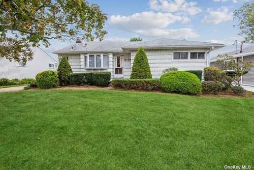 $519,000 - 4Br/3Ba -  for Sale in East Meadow