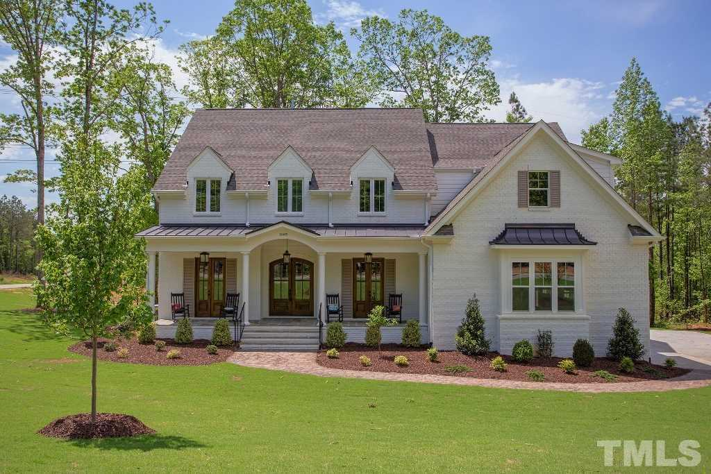 $800,000   4Br/4Ba   For Sale In Falls Reserve, Raleigh MLS Logo